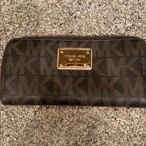 Brown and Gold Michael Kors accordion wallet.